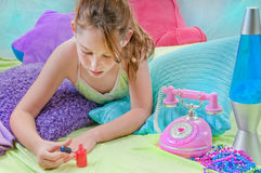 Young girl relaxing Royalty Free Stock Image