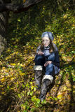 Young girl relaxing in autumn forest Royalty Free Stock Images