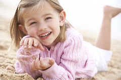 Young Girl Relaxing On Beach Royalty Free Stock Image
