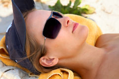 Young girl relaxing at the beach. Royalty Free Stock Photography
