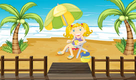 A young girl relaxing at the beach Stock Photos