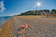 Young Girl relaxing on a beach Royalty Free Stock Images
