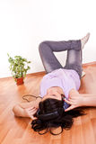 Young girl relaxing in empty room Stock Photography