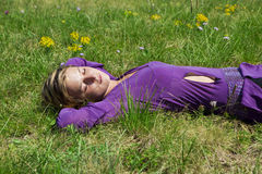 Young girl relaxing on the grass Royalty Free Stock Photo