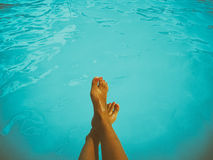 Young Girl Relaxing Her Feet At Swimming Pool. Retro Young Girl Relaxing Her Feet At Swimming Pool Royalty Free Stock Images