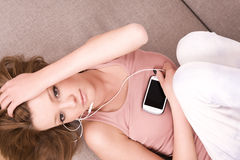 Young girl relaxing and listening a music Royalty Free Stock Photo
