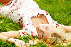 Young girl relaxing on a meadow Stock Photography