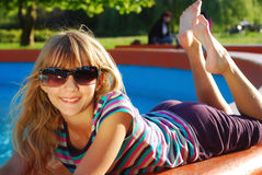 Young girl relaxing in the park Stock Images