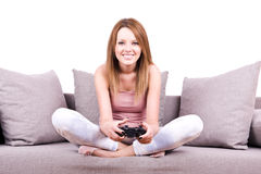 Young girl relaxing and playing video games Royalty Free Stock Photos