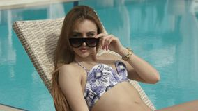 Young Girl Relaxing At The Pool stock footage