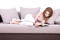 Young girl relaxing and reading a book Royalty Free Stock Photo