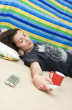Young Girl Relaxing With Remote Control Angled Stock Photo