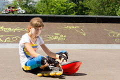 Young girl relaxing at the skate park Stock Images