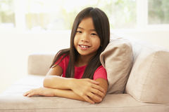 Young Girl Relaxing On Sofa At Home Stock Image