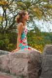 Young girl relaxing on the stone Royalty Free Stock Image