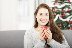 Young girl relaxing with warm tea at christmas Stock Photo