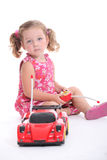 Young girl with remote-control car. Young girl playing with a remote-control car Royalty Free Stock Images