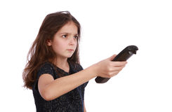 Young girl with remote control. Studio shot of a young girl with a remote control on a white background Royalty Free Stock Photos