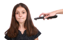 Young girl with remote control. Studio shot of a young girl with a remote control on a white background Royalty Free Stock Photo