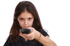 Young girl with remote control. Studio shot of a young girl with a remote control on a white background Stock Photo