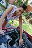 Young girl repair car Stock Photography
