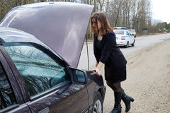 Young girl repairs the car stock image