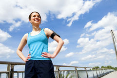 Young girl rest after running. Over sky smiling. Royalty Free Stock Photography