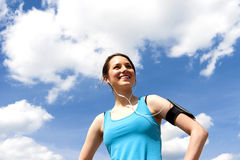 Young girl rest after running. Over sky smiling. Royalty Free Stock Photos