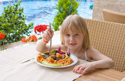 Young girl in restaurant. Young girl eating in restaurant Stock Image