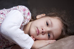 Young girl resting. On cushion Royalty Free Stock Images