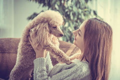 Young girl is resting with a dog . Royalty Free Stock Image