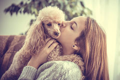 Young girl is resting with a dog . Royalty Free Stock Photos