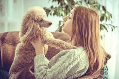 Young girl is resting with a dog . Stock Image