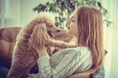 Young girl is resting with a dog . Royalty Free Stock Photography