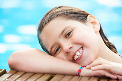 Young Girl Resting On The Edge Of Swimming Pool Stock Image