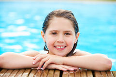 Young Girl Resting On The Edge Of Swimming Pool Stock Images