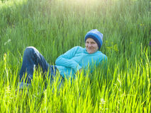 Young girl resting on the grass. Royalty Free Stock Image