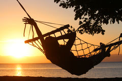 Young girl resting in a hammock overlooking the sea Stock Photo