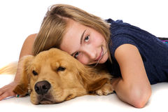 Young girl resting with her dog. A pretty young girl rests comfortably with her golden retriever dog Royalty Free Stock Image