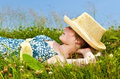 Young girl resting in meadow Royalty Free Stock Image
