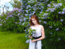 Young girl resting in a park. With flowers Stock Photography
