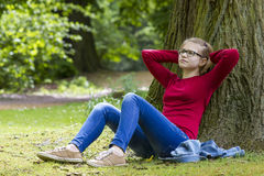 Young girl resting in the park Stock Image