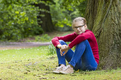 Young girl resting in the park Royalty Free Stock Images