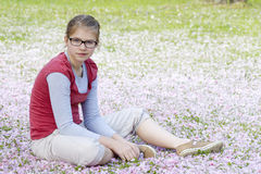 Young girl resting in park Stock Images