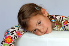 Young girl resting on sofa Royalty Free Stock Image
