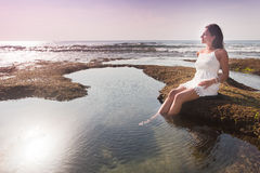 Young girl resting at the water Stock Photo