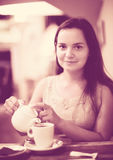 Young girl rests in cafe Royalty Free Stock Images