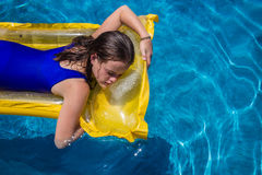 Girl Lilo Blue Pool Stock Images