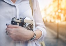 Young girl with a retro camera stock image