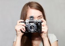 Young girl and retro camera. Happy young girl and retro camera. Hobby Stock Image
